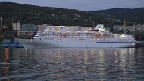 Night view of Cruise liner Pacific Venus in Kamchatka Peninsula Seaport stock video footage