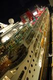 Night view of cruise ship. Cruise ship docked at exotic port with night lights royalty free stock images