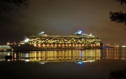 Night view of cruise ship in port. Passengers about to leave on exciting cruise vacation Royalty Free Stock Image