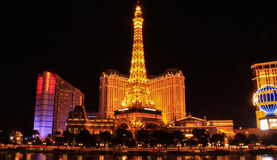 : Night view of the dancing fountains of Bellagio and the Eiffel Tower replica Stock Photo