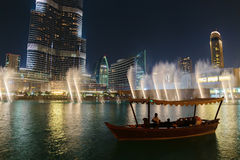 Night view Dancing fountains downtown and in a man-made lake in Stock Photo