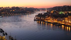 Night view of the Douro river and Ribeiro in Porto stock video