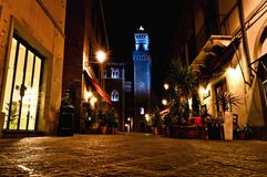 Night view of downtown with enlightened Town Hall in Piombino, Italy. PIOMBINO, ITALY - APRIL 17: night view of downtown with enlightened Town Hall in Piombino Royalty Free Stock Image
