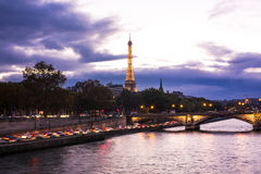Night view on Eiffel tower. From Alexander III bridge in Paris Royalty Free Stock Images
