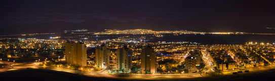 Night view on Eilat and Aqaba cities. Panoramic view on the Gulf of Aqaba from Eilat's rocks Stock Image