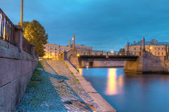 Night view on embankment of Griboedov Canal and Krasnogvardeysky Bridge Royalty Free Stock Photo