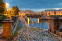 Night view on embankment of Griboedov Canal and Krasnogvardeysky Bridge Royalty Free Stock Photography