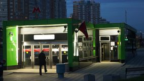 Night view of the entrance of the metro station Ramenki and traffic on Michurinsky Avenue, Moscow. Near the entrance into the underground station Ramenki it`s stock footage
