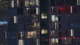 Night view of exterior apartment tower. High rise skyscraper with blinking lights in windows. Night view of office and apartment building. High rise skyscraper stock video footage