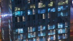 Night view of exterior apartment tower. High rise skyscraper with blinking lights in windows. Night view of office and apartment building. High rise skyscraper stock video