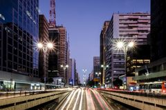 Night view of the famous Paulista Avenue, financial center of the city and one of the main places of Sao Paulo, Brazil. Night view of the famous Paulista Avenue royalty free stock photos