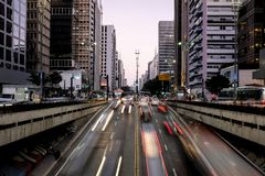 Night view of the famous Paulista Avenue, financial center of the city and one of the main places of Sao Paulo, Brazil. Night view of the famous Paulista Avenue royalty free stock image