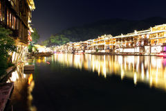 Night view Fenghuang, Hunan province, China. Fenghuang-Phoenix County at night, lighting the colorful, like a dream and magic. Fenghuang, located in the Royalty Free Stock Photo