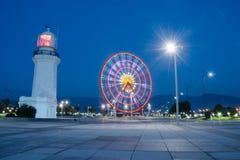 Night view of ferris wheel and old lighthouse,Batumi,Georgia Stock Photo