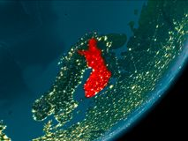 Finland from space at night. Night view of Finland highlighted in red on planet Earth with atmosphere. 3D illustration. Elements of this image furnished by NASA Royalty Free Stock Images