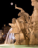 Night view of Fontana dei quattro fiumi, Piazza Navona. The statue of Rio de la Plata god, particular of the Four Rivers Fountain in Piazza Navona, Rome. It was Royalty Free Stock Photo