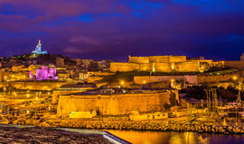 Night view of Fort St. Nicolas and Notre-Dame-de-la-Garde in Mar Royalty Free Stock Image