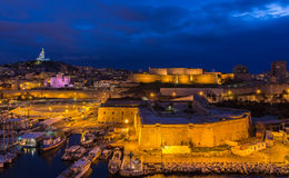 Night view of Fort St. Nicolas and Notre-Dame-de-la-Garde Stock Photography