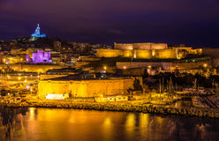 Night view of Fort St. Nicolas and Notre-Dame-de-la-Garde. In Marseille, France Royalty Free Stock Photo