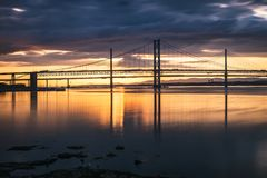 Night view of the Forth Road Bridge and Queensferry Crossing in stock photos