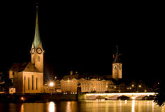 The night view of the Fraumunster in Zurich. The night view of the Fraumunster Church in Zurich Switzerland. River - Limmat royalty free stock photo