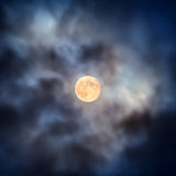 Night view at full moon through moving clouds. Night view at the full moon through moving blue clouds. Abstract scene Stock Photo