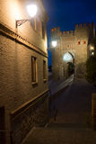 Night view. The gate in Toledo Stock Photography