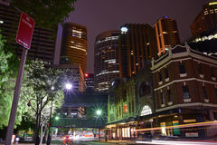 Night view of George Street nearby The Rock. This image is taken facing the central business district CBD with the Sydney Train track visible in the middle. In Stock Photo