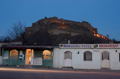 Night view of Gori fortress from street market,Georgia royalty free stock photography