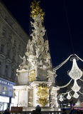 Night view of Graben street in Vienn. VIENNA, AUSTRIA - JANUARY 1 2016: Night view of Graben street in Vienna during Christmas time, with Pestsaule memorial Royalty Free Stock Photo