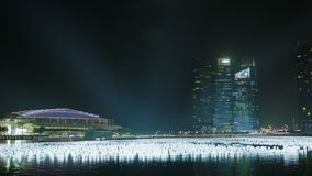 Night view of the Gulf. View of the Marina Bay Sands hotel and office high-rise buildings stock video footage