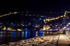 Night view of harbour, fortress and ancient shipyard in Alanya, Turkey. Stock Photo
