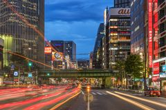 Night view of the Harumi street leading to Ginza district near t. O the entrance of the Hibiya Park 日比谷公園 Hibiya Kōen in Chiyoda stock images
