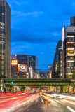 Night view of the Harumi street leading to Ginza district near t. O the entrance of the Hibiya Park 日比谷公園 Hibiya Kōen in Chiyoda stock image