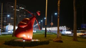 Night view of a heart inverted cupid statue, Lima. Lima, Peru. March 25, 2017. Lovely night view of a red Cupid statue located in Miraflores touristic district Stock Photo