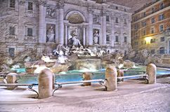 Night view with heavy snowfall on Trevi Fountain square, the largest Baroque fountain in the city and one of the most famous foun. Tains in the world located in stock photo