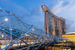 Night view of Helix Bridge and Marina Bay Sands Royalty Free Stock Photo