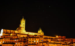 A night view of the historic center of Siena in Tuscany. With the cathedral royalty free stock photography