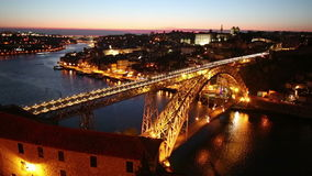 Night view of the historic city of Porto, Portugal with the Dom Luiz bridge stock video footage