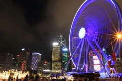 Night view HK Observatory Wheel and Amusement Park. Night view of the 60-meter high Hong Kong Observatory Wheel and the HK famous Lai Yuen Amusement Pack after Royalty Free Stock Images