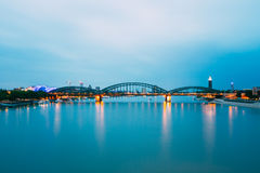 Night View Of Hohenzollern Arch Bridge Over River Rhine, Germany. Night Evening View Of Hohenzollern Arch Bridge Over The River Rhine, Germany. Europe Royalty Free Stock Photos
