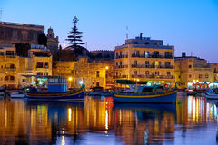 The night view of houses and hotels of Marsaskala reflecting in Stock Images