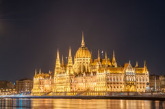 Night view of the Hungarian Parliament Building on the bank of the Danube in Budapest, Hungary Stock Photo