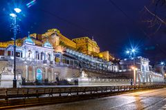 Night view of illuminated Budapest with Danube river, palace and bridge. Night view of illuminated Budapest with Danube river, palace and bridge, Hungary Royalty Free Stock Image