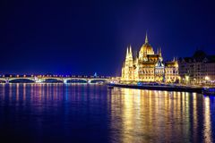 Night view of illuminated Budapest with Danube river, parliament, and bridge. Night view of illuminated Budapest with Danube river, parliament, and bridge Royalty Free Stock Photo