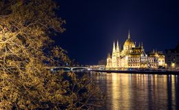 Night view of illuminated Budapest with Danube river, parliament, and bridge. Night view of illuminated Budapest with Danube river, parliament, and bridge Stock Images