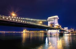 Night view of illuminated Budapest with Danube river, parliament, palace and bridge. Night view of illuminated Budapest with Danube river, parliament, palace Stock Photography