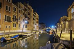 Night view of a illuminated chanal and houses. Night view of a illuminated canal and colorful houses in Venice royalty free stock images