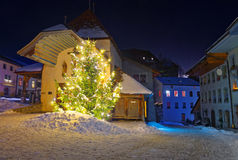 Night view of the illuminated Christmas fir tree in the street o Royalty Free Stock Photo