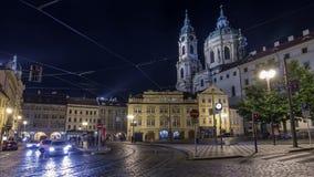Night view of the illuminated malostranske namesti square timelapse hyperlapse in prague stock video